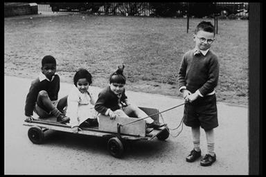 A picture of a child with a homemade gocart