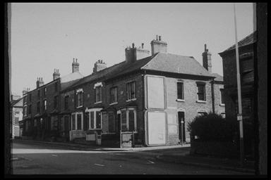A picture of a row of small derelict terraced houses