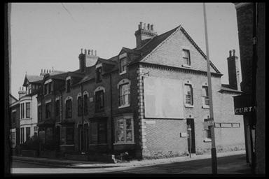 A picture of a row of derelict three story terraced houses