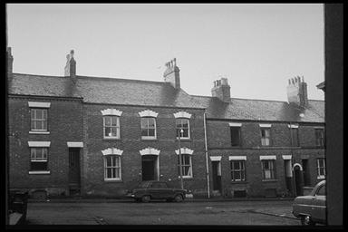 A picture of a row of various terraced houses
