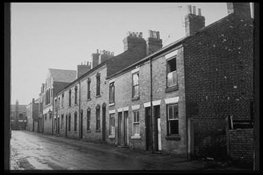 A picture of a row of various terraced houses on a hill