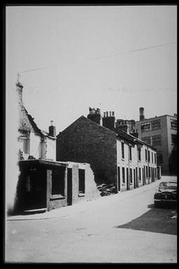 A picture of a row of partly demolished houses