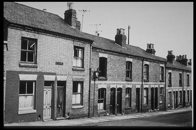 A picture of a row of terraced houses from the top of the road