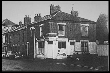 A picture of the corner of a row of old terraced houses