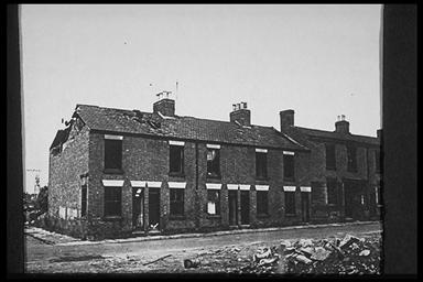 A picture of a partly demolished row of terraced houses