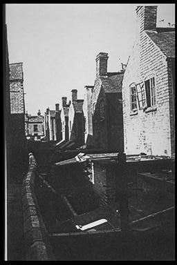 A picture of a long row of rear yards of terraced houses