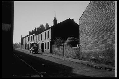 A picture of a row of old terraced houses