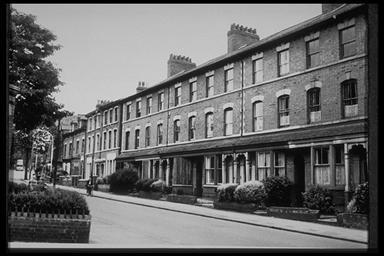 A picture of the front of a row of very neat terraced houses