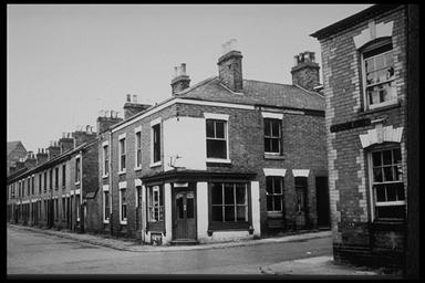 A picture of the corner of two rows of terraced houses