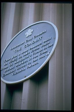 A picture of a round blue plaque