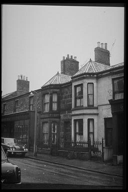 A picture of a couple of old bow-fronted terraced houses