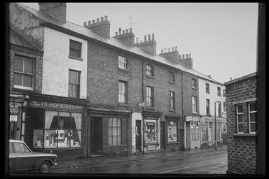 A picture of a row of terraced houses where the lower floor has been converted into shops