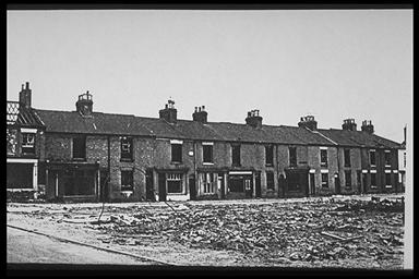 An image of an old photo showing bombed out buildings