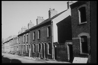 A picture of a row of empty, derelict terraced houses