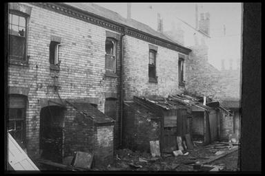 A picture of the rear of a row of empty terraced houses