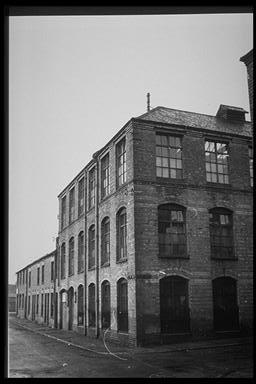 A picture of a large three story factory building
