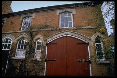 A picture of a large building with an arched double door
