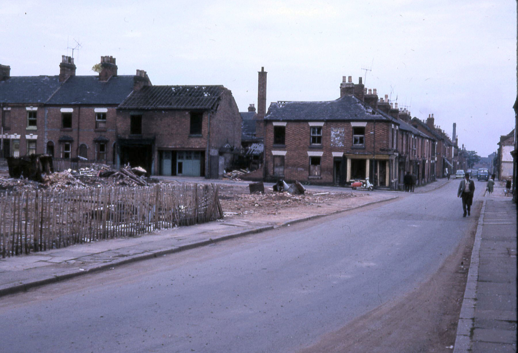 Street scene, one side of the road demolished.