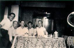 A picture of B.D. [centre] at home with friends 1941.