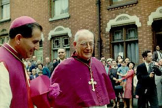 A picture of Bishop Rubin [now Cardinal] in assistance of the Dominican Preor [centre] 1957.