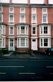 A picture of a section of large terraced houses