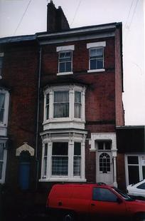 A picture of a tall end terraced house