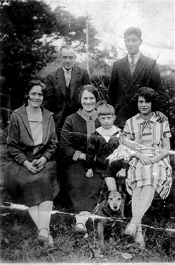 A picture of George and Emma Hunt [couple on the right] with his Mother [our Grandma] in the centre with her boy on her knee, Grandad is standing at the back. 1929.