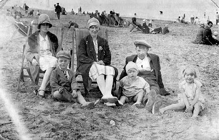 A picture of a family at the seaside
