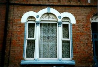 A picture of an intricate stone-mullioned window