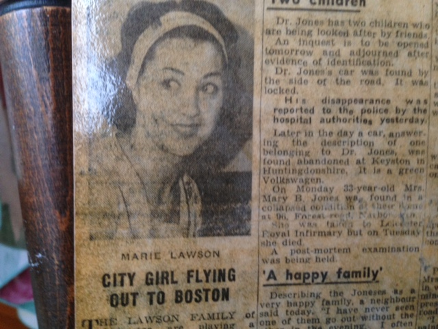 Newspaper clipping with black and white portrait of a young woman