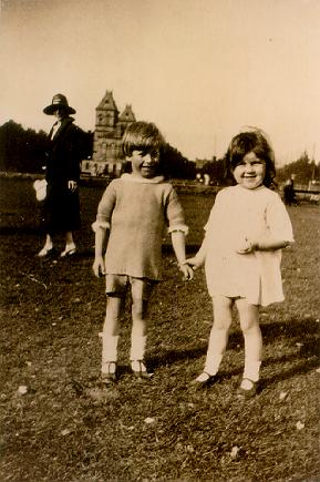 A photograph of two children holding hands