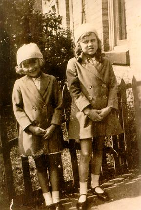 A picture of two young girls standing next to each other